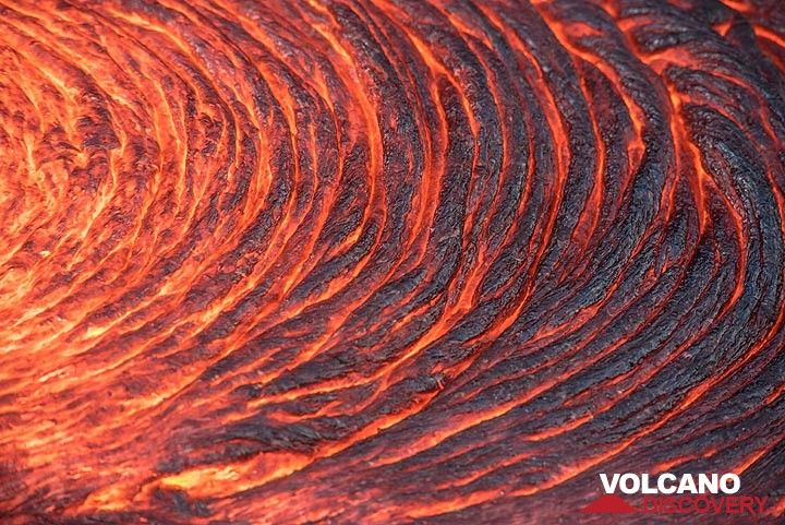 "Actively forming, regular lava ""ropes"" on a breakout flow. (Photo: Tom Pfeiffer)"