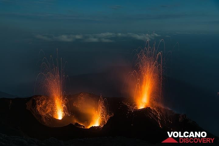 Triple eruption from the western, central and eastern vents of Stromboli volcano. The island's moonlight shadow can be seen in the background over the sea. (Photo: Tom Pfeiffer)