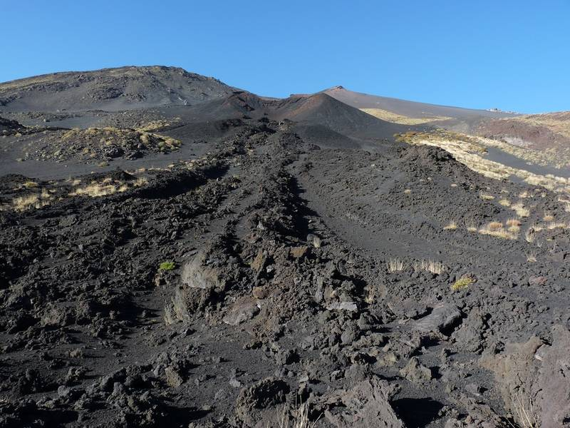 One of the many eruption cones on Etna's flanks, with a lava channel emerging from it in the foreground. Italy's Volcanoes: The Grand Tour, October 2013 (Photo: Ingrid)