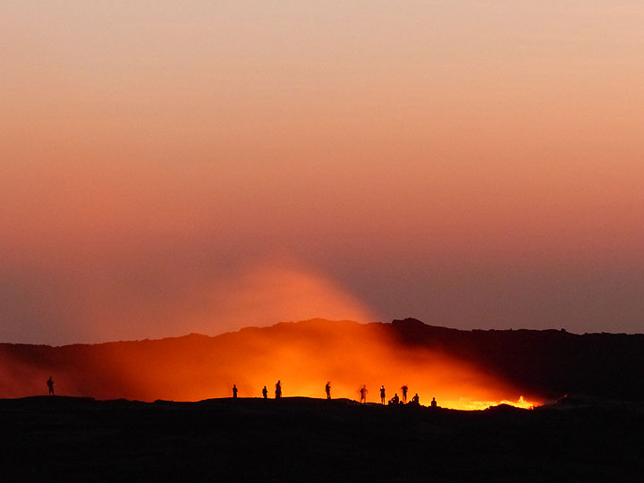 DAYS 5-6-7: Erta Ale - Observing the lava lake from the rim of the active vent around sunrise. (Photo: Ingrid)