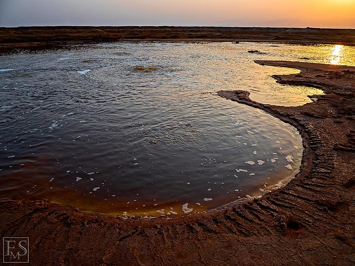 Sun set over a large acid hydrothermal pond and salt deposits near Dallol and Assale salt lake (Photo: Stefan Tommasini)