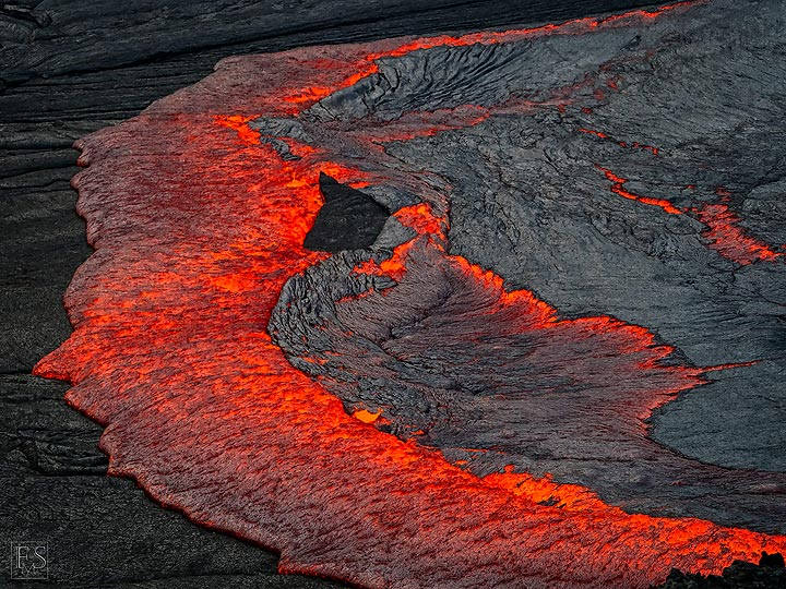 The lava lake's black crust is continuously renewed when liquid lava from below overflows and recycles it (Erta Ale fissure eruption) (c)