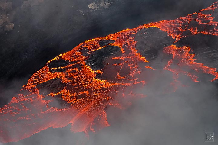 Close up of the edge of the active lava lake now deep down in the south crater of Erta Ale's summit caldera (Photo: Stefan Tommasini)