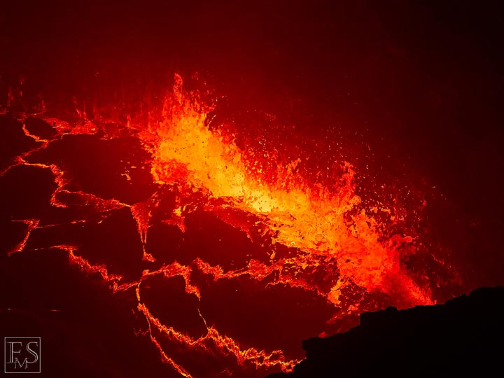 Gas rising up and exploding through the lava lake's surface creates lots of spattering at the edge of the lake (south crater inside Erta Ale's summit caldera) (Photo: Stefan Tommasini)